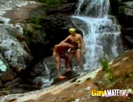 Amazing gay blowjob on waterfalls